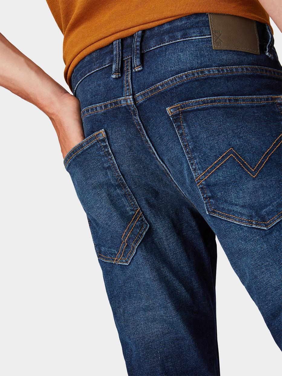 Джинсы Tom TailorДжинсы<br>Джинсы с небольшим эффектом потертости ткани|пятикарманный стиль|потайная застежка-молния|содержат эластан для идеальной посадки|покрой Aedan Slim: низкая линия талии, прямой крой штанин